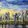 Четыре слона на фоне яркого неба.